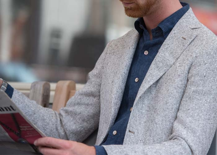 man reading a newspaper in his Barba Napoli Jacket